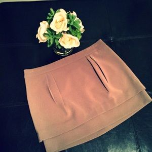 Khaki-colored, pleated-front Express mini skirt
